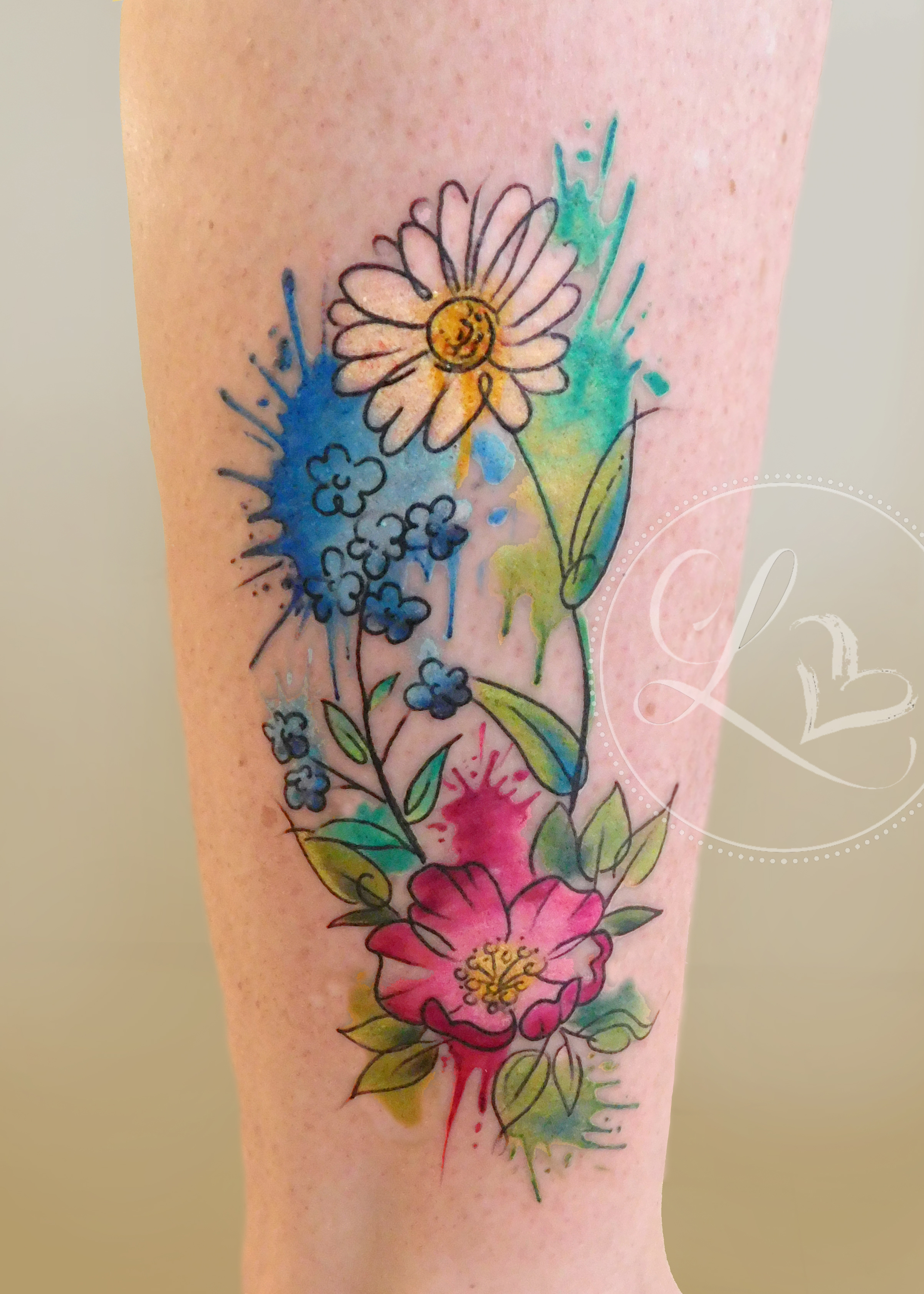 Watercolor style colorful floral bouquet on a leg featuring a daisy, forget me not, and dogwood rose