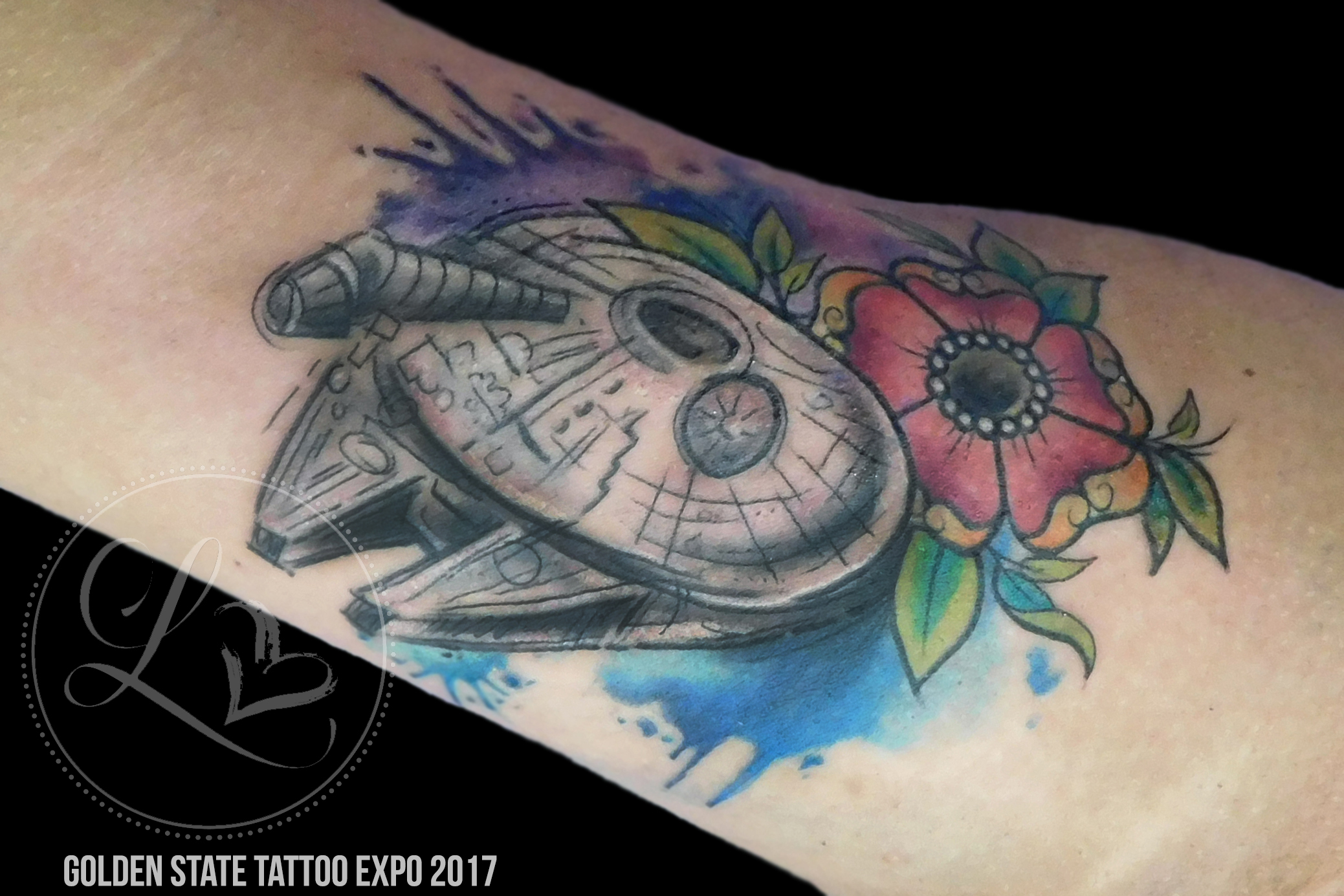 Watercolor Star Wars millenium falcon tattoo with flowers