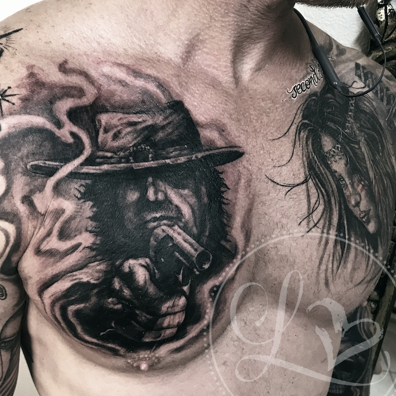 cowboy indian portrait chest tattoo black and grey