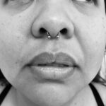 Septum piercing with a 16g circular barbell