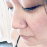Nostril piercing with a 14k yellow gold real diamond nostril screw, done by Lhena at Queen of Hearts - Wailuku, Maui