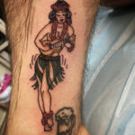 Sailor Jerry traditional hula girl tattoo by QOH artist Sophia